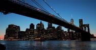 Stock Video Footage of New York City Brooklyn Bridge skyline sunset evening night