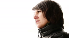 Pensive attractive sad woman looking to sea from ship, portrait Stock Footage