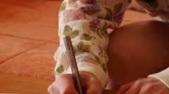 Woman writing with pen - close up dolly shot Stock Footage