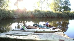 Father and son fishing together on lake. Family resting Stock Footage