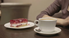 Woman drinks coffee with a cake Stock Footage