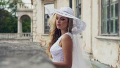 Chic aristocratic woman in retro style white dress and hat. Long blond straight Stock Footage