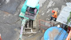 Backhoe Machine working at construction Site in Bangkok Thailand Stock Footage