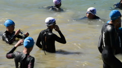 Triathlon runners before the swimming in a swamp Stock Footage
