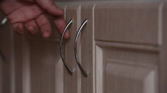 Man opens the door of the kitchen cabinet Stock Footage