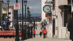 People walk by the street of Punta Arenas town, Chile. Stock Footage