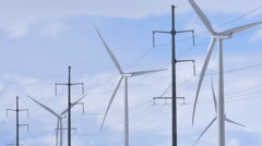 Row of Wind Turbines with Power Lines 01 Stock Footage