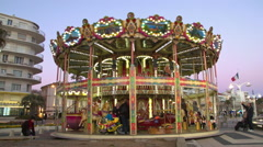Spinning Carousel at Sunset in MARSEILLE, FRANCE Stock Footage