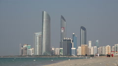 Stock Video Footage of Abu Dhabi skyline, Corniche beach, modern, expensive, skyscrapers, UAE