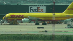 DHL and Fedex International air Freight Business Stock Footage