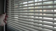 window blinds close open entering light - stock footage