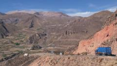 Trucks pass by the high mountain road to Bolivian border, Chile. Stock Footage