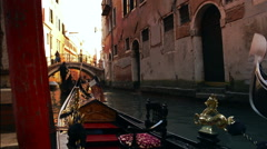 Gondoliere tourguiding his clients through Venice Italy 1 Stock Footage