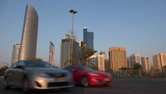 Abu Dhabi, traffic drives along the Corniche road Stock Footage