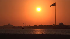 Abu Dhabi, sunset, flagpole, beach, Corniche, Middle East Stock Footage