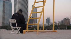 Security guard at the Corniche beach in Abu Dhabi, UAE - stock footage