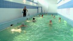 Women do water aerobics in the pool Stock Footage
