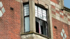 Derelict building red brick broken window Stock Footage