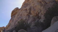 Man Climbing Steep Rock Face- Joshua Tree National Park Stock Footage