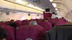 Qatar Airways flight, cabin interior, Kathmandu to Doha Stock Footage