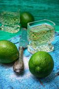 alcoholic cocktail with additions of lime - stock photo