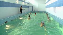 women do water aerobics in the pool - stock footage