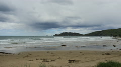 New Zealand Catlins Nugget Point clouds over promontory Stock Footage