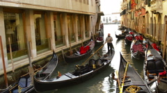 Gondola leaving large canal of Venice Italy Stock Footage