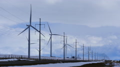 Wind Turbine with Power Lines ws Stock Footage