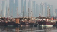 Doha Qatar dhow harbor city skyline history modern contrast Middle East Stock Footage