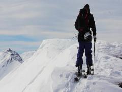 Ski touring on mountain peak - stock footage