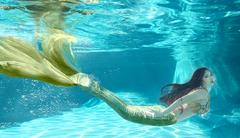 Beautiful Swimming Like a Mermaid Underwater Outdoors - stock photo