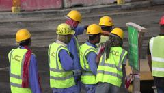 Migrant workers gather at construction site in Doha, Qatar - stock footage