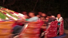 Multi-Colored Carousel Spinning with Fun-filled Passengers Stock Footage