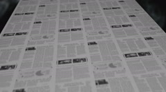 Breaking news out of a newspaper printing press loop - stock footage
