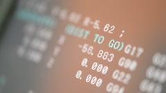CNC machine monitor looks like hackers display program code running numbers. DOF - stock footage