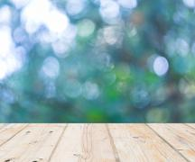 Wooden floor and out of focus bokeh background - stock illustration