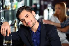 Young man in the bar Stock Photos