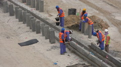 Migrant workers doing road work in Doha, Qatar Stock Footage