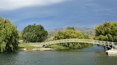 New Zealand Lake Dunstan Pisa Moorings bridge and willow trees Stock Footage