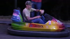 Teen Boy Drives Bumper Car and Laughs Stock Footage