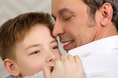 Sincere love of parent and child Stock Photos