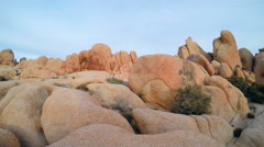 Joshua Tree National Park- Pan From Rocks To Sunset Stock Footage