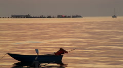 Tropical Red sun rises, shimmering silver sea & boats time-lapse Stock Footage