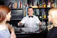 Barman stretches out coffee Stock Photos