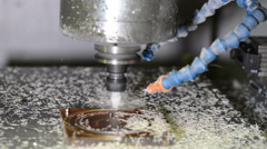 Working CNC milling machine drills in plastic detail making plastic shaving Stock Footage