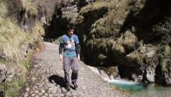 Hiking - Walk into a gorge on cobbled path Romano Stock Footage