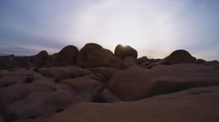 Joshua Tree National Park- Pan From Sun To Rocky Valley Stock Footage