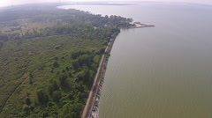Aerial View Panning over Green Lake Erie During Algal Bloom Stock Footage