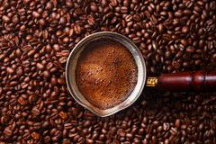 Hot coffee prepared in a Turk. Stock Photos